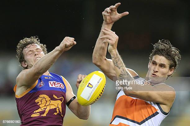 Ryan Lester of the Lions spoils a mark from Rory Lobb of the Giants during the round 17 AFL match between the Brisbane Broncos and the Greater...