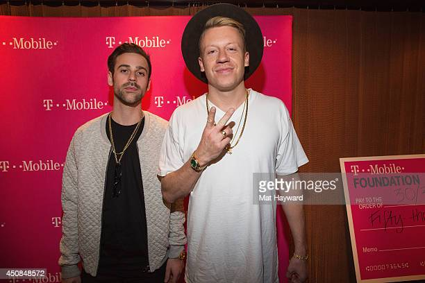 Ryan Lewis and Macklemore of Macklemore and Ryan Lewis pose for a photo backstage as TMobile Unleashes Music Freedom at Paramount Theatre on June 18...