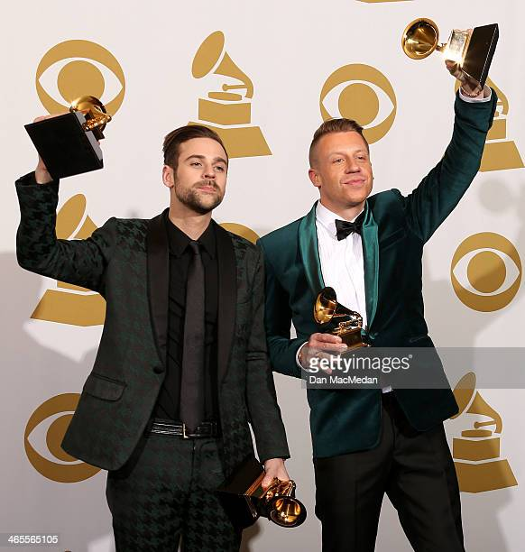 Ryan Lewis and Macklemore pose in the press room at the 56th Annual GRAMMY Awards at Staples Center on January 26 2014 in Los Angeles California