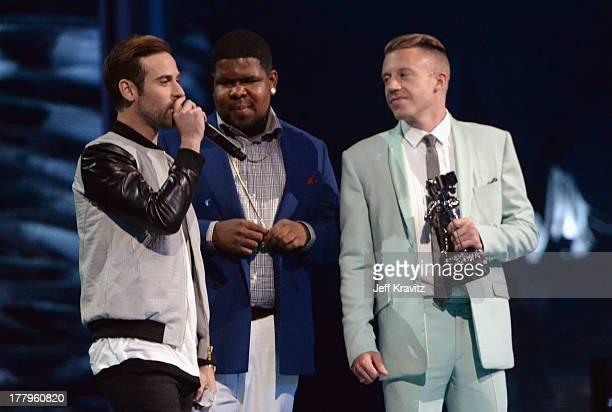 Ryan Lewis Ray Dalton and Macklemore speak onstage during the 2013 MTV Video Music Awards at the Barclays Center on August 25 2013 in the Brooklyn...