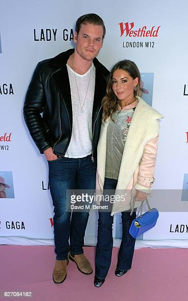 Ryan Libbey and Louise Thompson attend a surprise festive performance by Lady Gaga on Westfield LondonÕs rooftop on December 1, 2016 in London,...