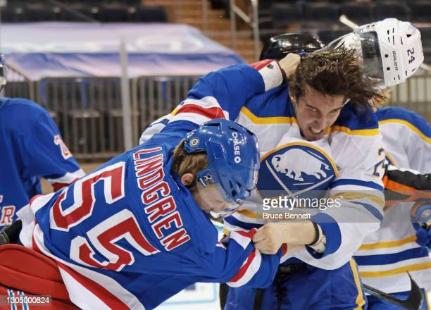 Ryan Lindgren of the New York Rangers and Dylan Cozens of the Buffalo Sabres fight during the third period at Madison Square Garden on March 02, 2021...