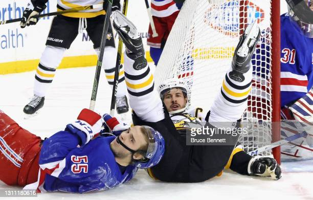 Ryan Lindgren of the New York Rangers gets called during the first period for holding Sidney Crosby of the Pittsburgh Penguins at Madison Square...