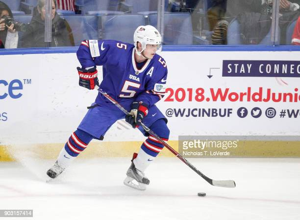 Ryan Lindgren of United States skates the ouck against Sweden during the second period of play in the IIHF World Junior Championships Semifinal game...