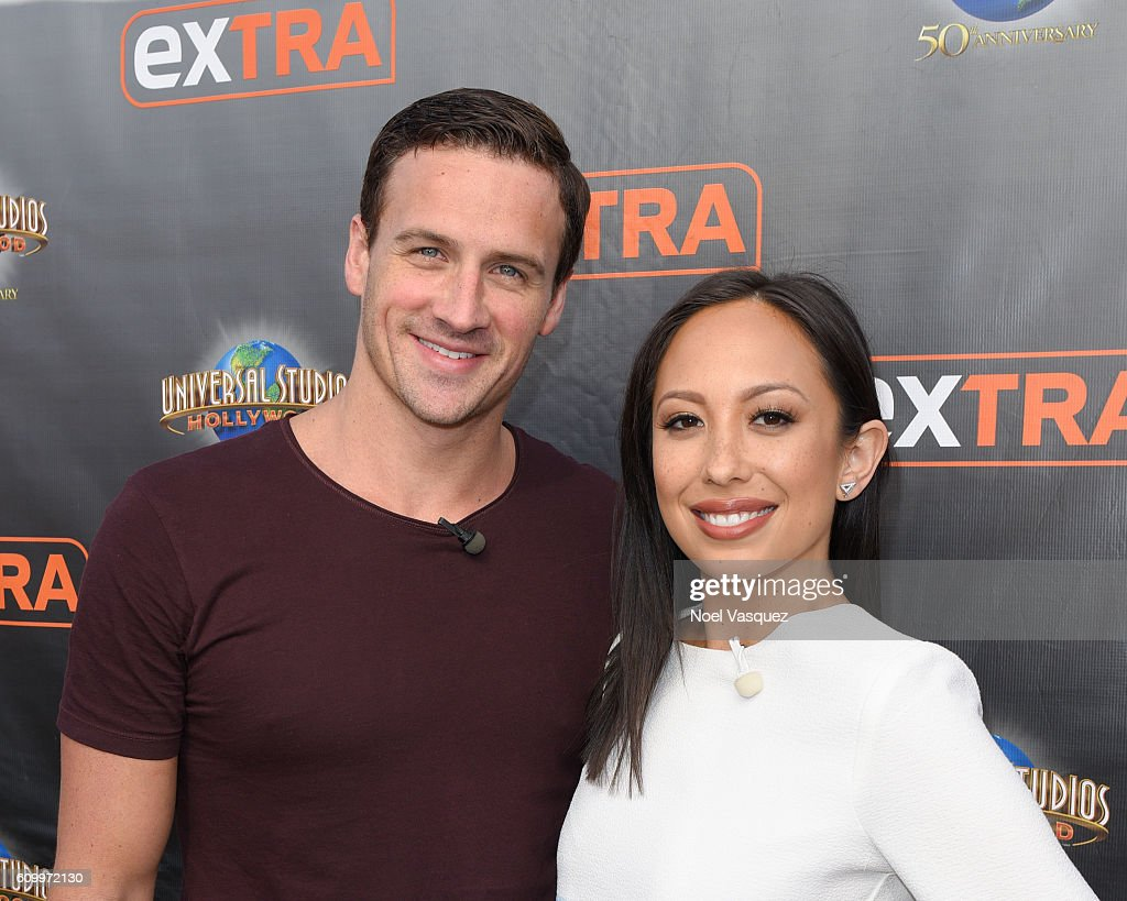 Ryan Lochte (L) and Cheryl Burke visit 'Extra' at Universal Studios Hollywood on September 23, 2016 in Universal City, California.