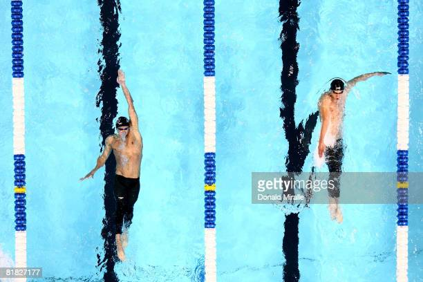 Ryan Lochte and Michael Phelps battle each other in the final of the 200 meter individual medley during the U.S. Swimming Olympic Trials on July 4,...