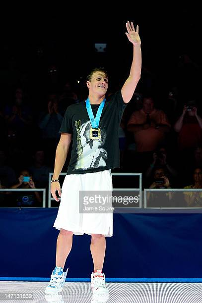 Ryan Lochte celebrates after he received his gold medal for finishing first in the championship final heat of the Men's 400 m Individual Medely...