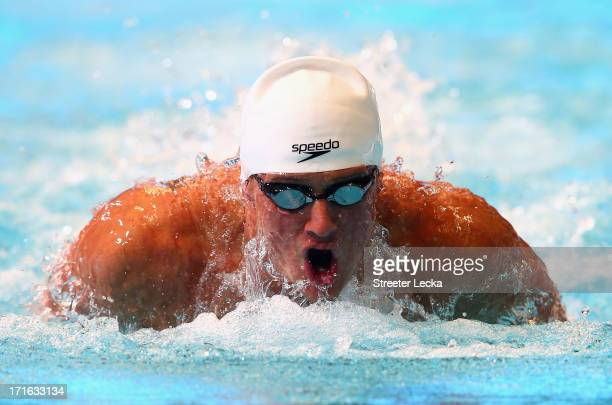 Ryan Lochte competes in the men's 100m butterfly preliminaries on day 3 of the 2013 USA Swimming Phillips 66 National Championships and World Trials...