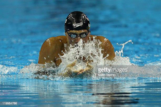 Ryan Lochte of the United States competes on the way to winning the gold medal in a new world record time in the Men's 200m Individual Medley Final...