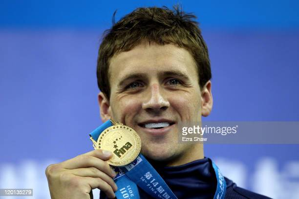 Ryan Lochte of the United States poses with his gold medal after the Men's 400m Individual Medley Final during Day Sixteen of the 14th FINA World...