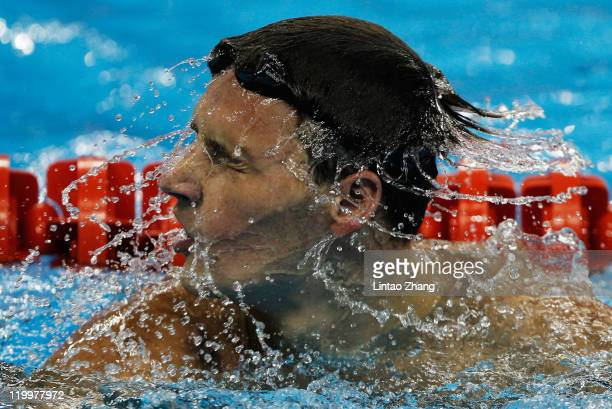 Ryan Lochte of the United States shakes water out of his hair after he swam in heat three of the Men's 200m Backstroke heats during Day Thirteen of...