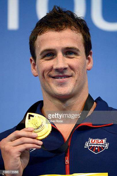 Ryan Lochte of USA poses with his Gold medal on the podium after winning the Men's 200m Individual Medley Final during day three of the 11th FINA...