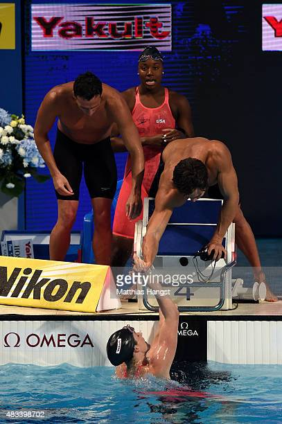 Ryan Lochte Simone Manuel and Nathan Adrian of the United States celebrate winning the gold medal with Missy Franklin in a new world record time of...