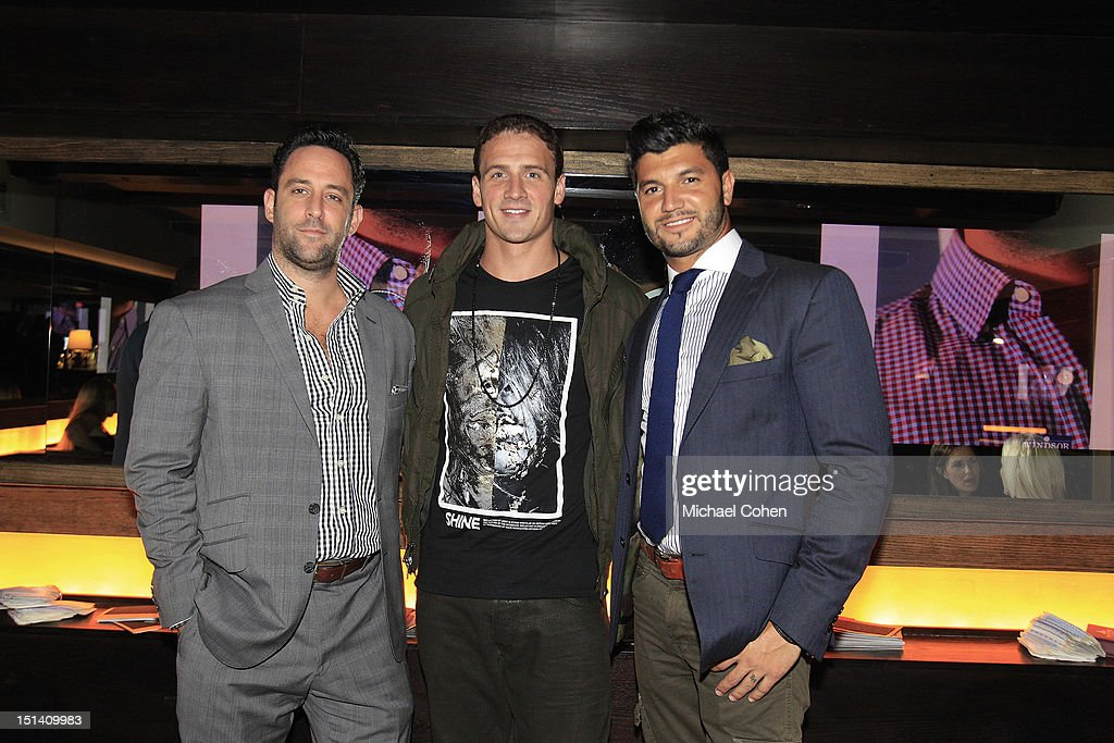 Ryan Lochte (C) with Matt Shendell (L) and Brian Mazza at a Wilson Custom fitting during Ryan Lochte Hosts 'Guys Fashions Night Out' Presented By Ainsworth Park and Windsor Custom on September 6, 2012 in New York City.