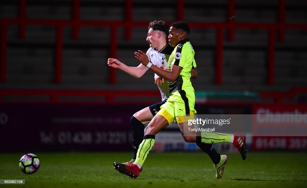 Ryan Loft of Tottenham Hotspur is tackled by Gabriel Osho of Reading during the Premier League 2 match between Tottenham Hotspur and Reading at The Lamex Stadium on March 13, 2017 in Stevenage, England.
