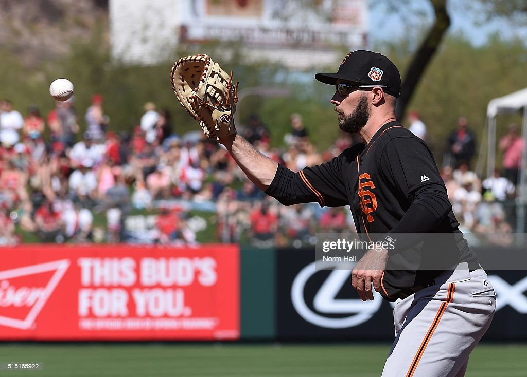 Ryan Lollis #50 of the San Francisco Giants makes a play on a bouncing ball against the Los Angeles Angels of Anaheim during the third inning at Tempe Diablo Stadium on March 12, 2016 in Tempe, Arizona.