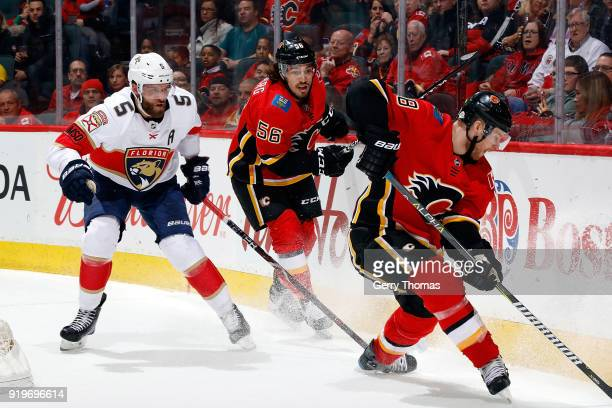 Ryan Lomberg of the Calgary Flames skates against Aaron Ekblad of the Florida Panthers during an NHL game on February 17 2018 at the Scotiabank...