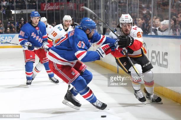 Ryan Lomberg of the Calgary Flames skates against Steven Kampfer of the New York Rangers at Madison Square Garden on February 9 2018 in New York City