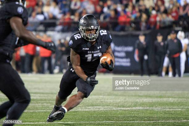 Ryan Londree of the Old Dominion Monarchs runs the ball in the game against the Western Kentucky Hilltoppers on October 20 2018 in Bowling Green...