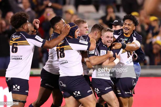 Ryan Lonergan of the Brumbies celebrates kicking the winning goal during the round three Super RugbyAU match between the Melbourne Rebels and the...