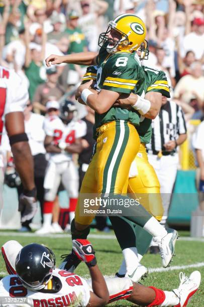 Ryan Longwell of the Green Bay Packers celebrates with teammate Doug Pederson in front of the fallen defense of Allen Rossum of the Atlanta Falcons...