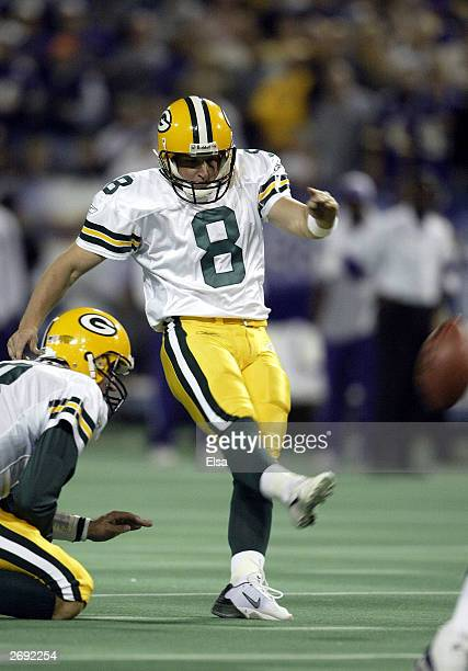Ryan Longwell of the Green Bay Packers kicks a field goal as Doug Pederson holds in the fourth quarter against the Minnesota Vikings on November 2...