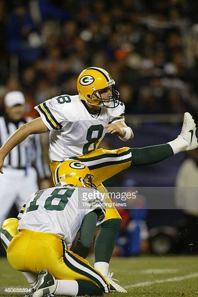 Ryan Longwell of the Green Bay Packers kicks a field goal on hold by Doug Pederson during a game against the Chicago Bears on September 29 2003 at...