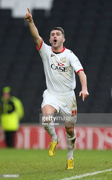 Ryan Lowe of Milton Keynes Dons celebrates after scoring his sides 1st goal during the npower League One match between Milton Keynes Dons and...