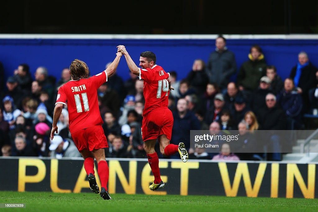 Ryan Lowe (R) of Milton Keynes Dons celebrates with team mate Alan Smith (L) after scoring his sides second goal during the FA Cup with Budweiser Fourth Round match between Queens Park Rangers and Milton Keynes Dons at Loftus Road on January 26, 2013 in London, England.