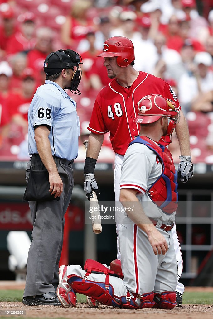 Ryan Ludwick #48 of the Cincinnati Reds argues a strike call with home plate umpire Chris Guccione during the game against the Philadelphia Phillies at Great American Ball Park on September 5, 2012 in Cincinnati, Ohio. The Phillies won 6-2.