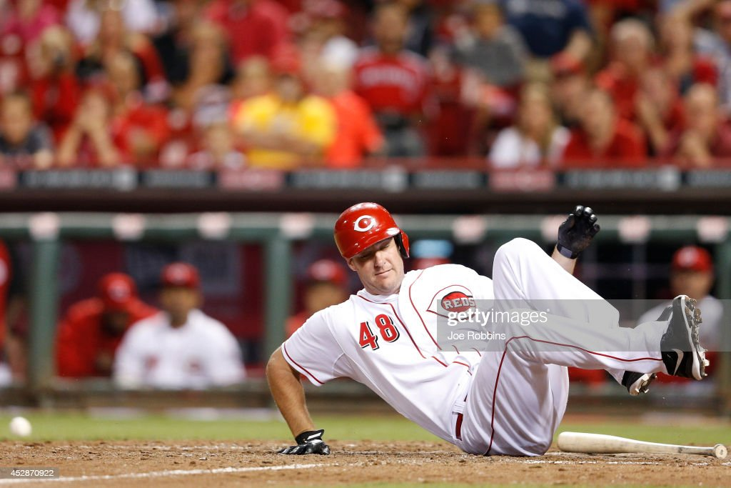 Ryan Ludwick #48 of the Cincinnati Reds gets hit by a pitch in the 13th inning of the game against the Arizona Diamondbacks at Great American Ball Park on July 28, 2014 in Cincinnati, Ohio. The Diamondbacks won 2-1 in 15 innings.