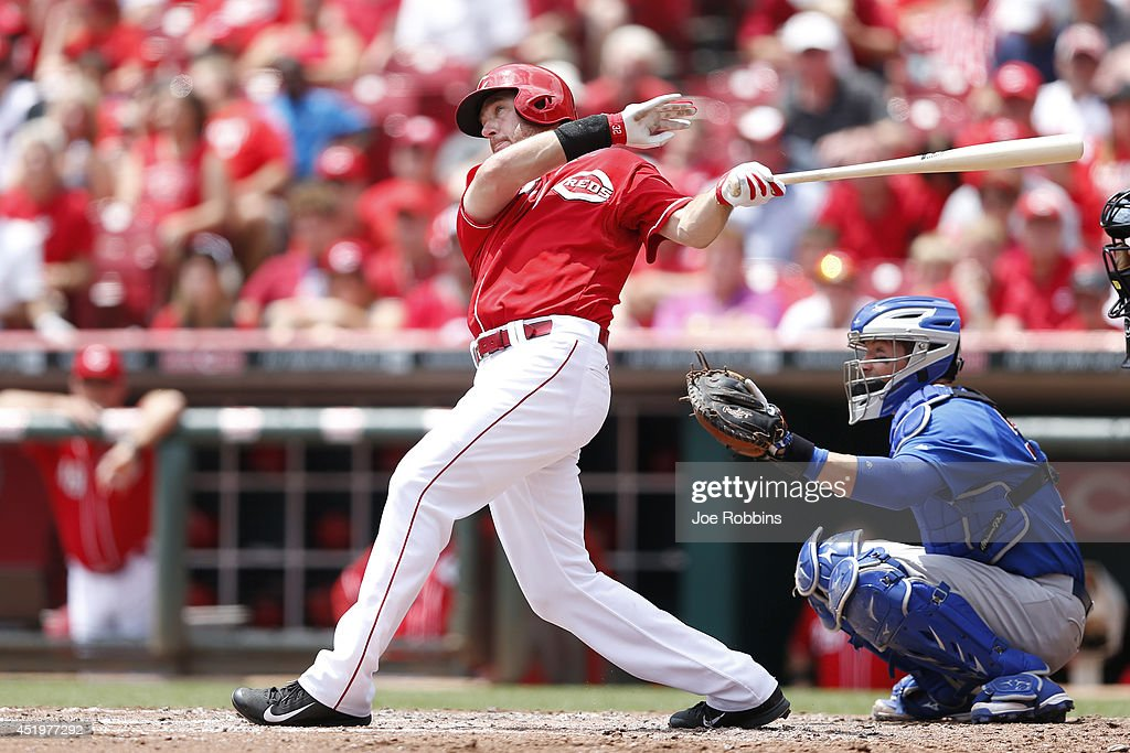 Ryan Ludwick #48 of the Cincinnati Reds hits a home run in the third inning of the game against the Chicago Cubs at Great American Ball Park on July 10, 2014 in Cincinnati, Ohio.