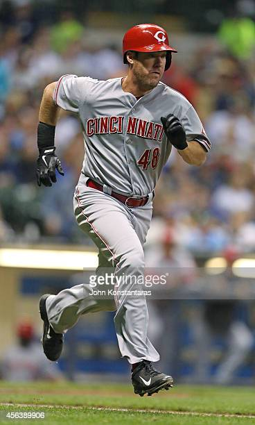 Ryan Ludwick of the Cincinnati Reds runs to first base after hitting a single during the seventh inning of their game against the Milwaukee Brewers...