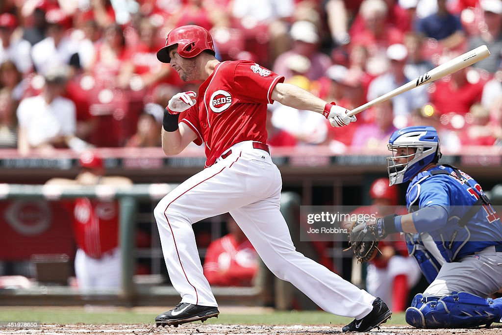 Ryan Ludwick #48 of the Cincinnati Reds singles to drive in a run in the first inning of the game against the Chicago Cubs at Great American Ball Park on July 10, 2014 in Cincinnati, Ohio.