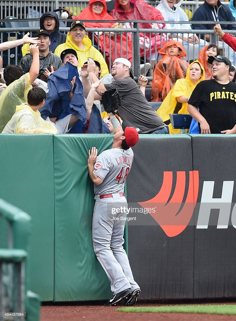 Ryan Ludwick #48 of the Cincinnati Reds watches a home run hit by Josh Harrison #5 of the Pittsburgh Pirates during the first inning on August 31, 2014 at PNC Park in Pittsburgh, Pennsylvania.