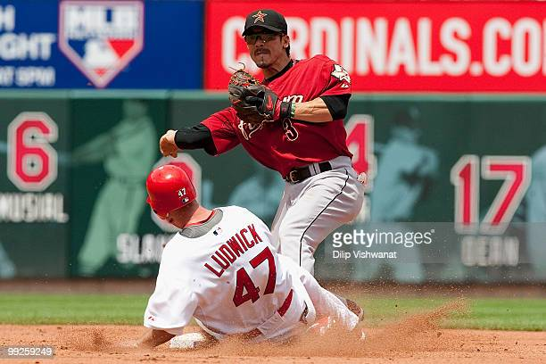 Ryan Ludwick of the St Louis Cardinals breaks up a double play against Kazuo Matsui of the Houston Astros at Busch Stadium on May 13 2010 in St Louis...