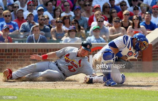 Ryan Ludwick of the St Louis Cardinals scores a seventh inning run past Geovany Soto of the Chicago Cubs on May 30 2010 at Wrigley Field in Chicago...