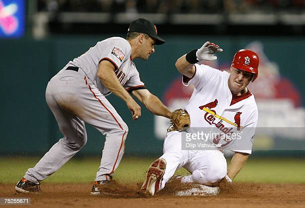 Ryan Ludwick of the St Louis Cardinals slides safely into second base against Omar Vizquel of the San Francisco Giants on July 6 2007 at Busch...