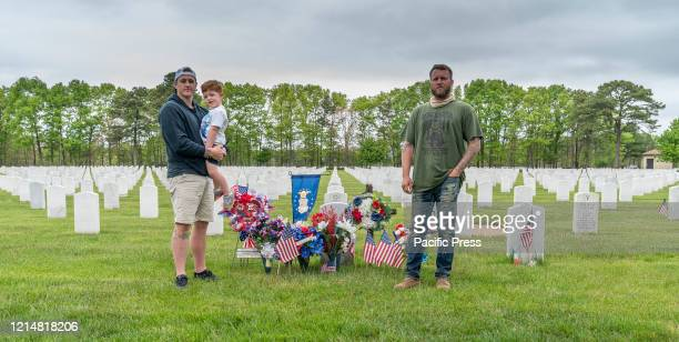 Ryan Lutz Ryan Lutz Jr Kenny Short visit a grave at Calverton National Cemetery for veterans during Memorial Day weekend Veterans of all confessions...