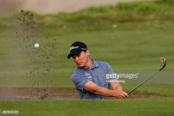 Ryan Lynch of Australia plays out of the bunker during day two of the 2015 Australian Masters at Huntingdale Golf Club on November 20, 2015 in...