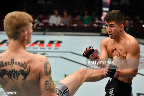 Ryan MacDonald kicks Louis Smolka in their bantamweight bout during the UFC Fight Night event at Rogers Arena on September 14, 2019 in Vancouver,...
