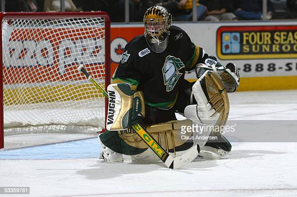 Ryan MacDonald of the London Knights follows the action in the corner during a Ontario Hockey League game against the Windsor Spitfires at the John...