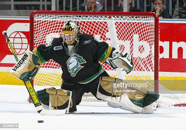 Ryan MacDonald of the London Knights looks to make a stick save during the Ontario Hockey League game against the Barrie Colts at John Labatt Centre...