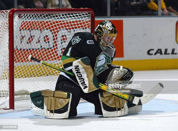 Ryan MacDonald of the London Knights makes a save during a Ontario Hockey League game against the Windsor Spitfires at the John Labatt Centre on...