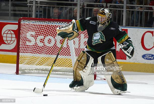 Ryan MacDonald of the London Knights steps out of crease to play the puck during a Ontario Hockey League game against the Windsor Spitfires at the...