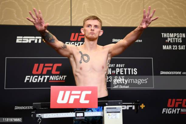 Ryan MacDonald poses on the scale during the UFC Fight Night weigh-in at Hilton Franklin Cool Springs on March 22, 2019 in Franklin, Tennessee.
