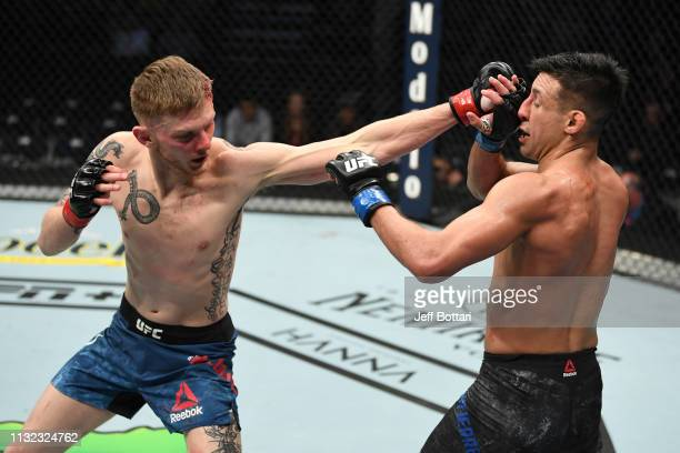 Ryan MacDonald punches Chris Gutierrez in their bantamweight bout during the UFC Fight Night event at Bridgestone Arena on March 23, 2019 in...