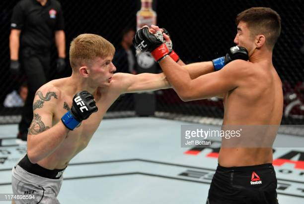 Ryan MacDonald punches Louis Smolka in their bantamweight bout during the UFC Fight Night event at Rogers Arena on September 14, 2019 in Vancouver,...
