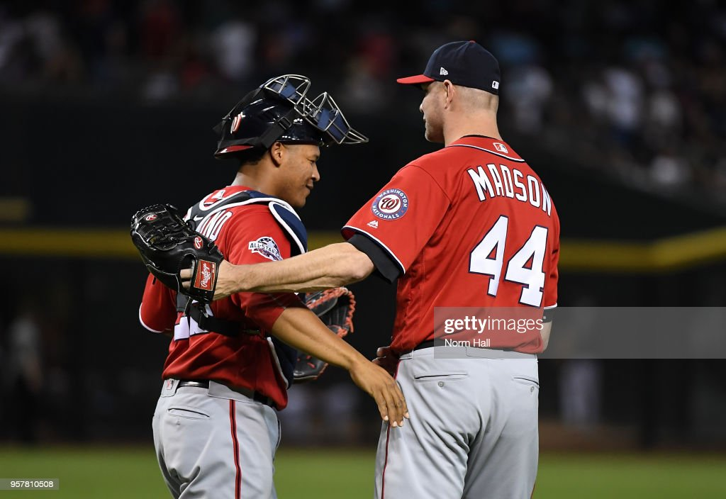 Ryan Madson #44 and Pedro Severino #29 of the Washington Nationals celebrate a 2-1 win against the Arizona Diamondbacks at Chase Field on May 12, 2018 in Phoenix, Arizona.