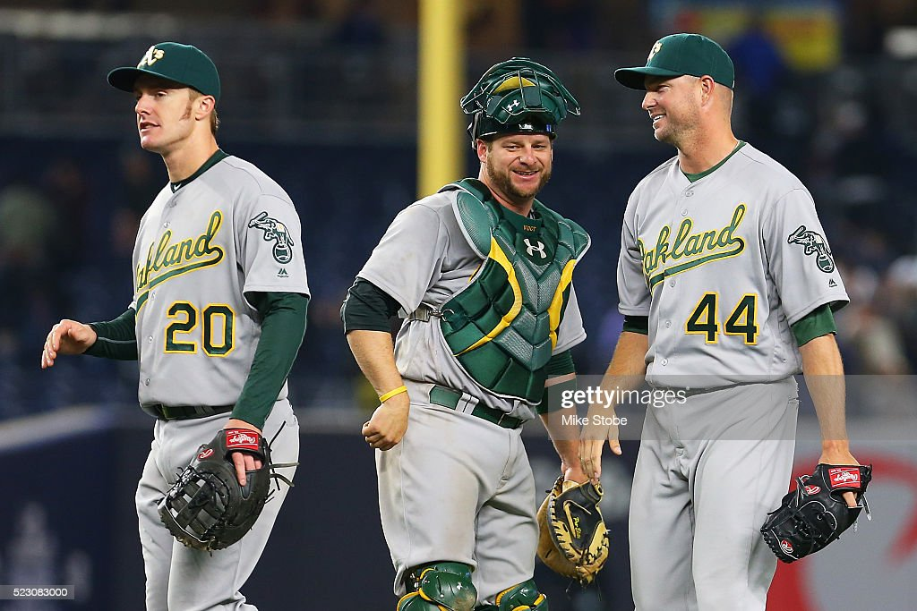 Ryan Madson #44, Mark Canha #20 and Stephen Vogt #21 of the Oakland Athletics celebrate after defeating the New York Yankees 7-3 at Yankee Stadium on April 21, 2016 in the Bronx borough of New York City.